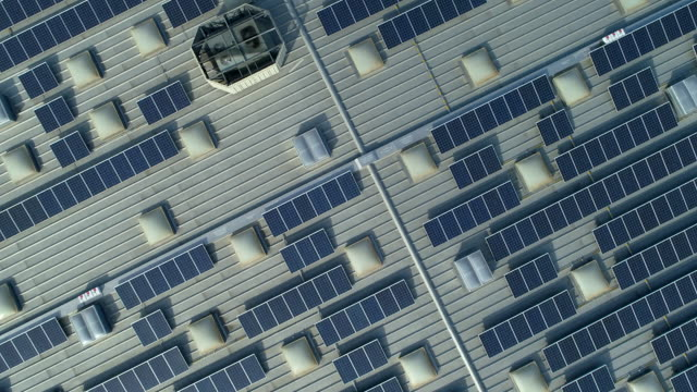 Solar panels on roof of the shopping mall. Drone point point of view.