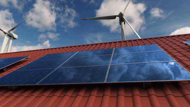 vídeos de stock e filmes b-roll de solar panels on the red roof of the private house and wind turbines generators - equipamento solar