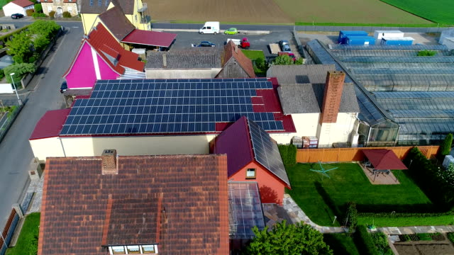 Solar panels on the roof of the house, the extraction of electricity by solar panels, personal solar power station