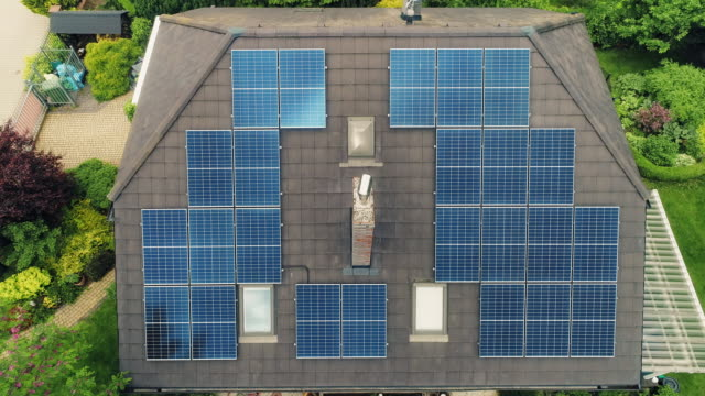 Solar panels on the rooftops. Aerial view.