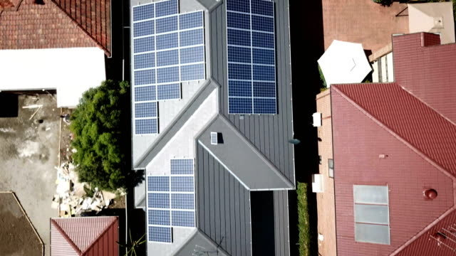 solar panels on the rooftops. aerial view - solar panels stock videos & royalty-free footage