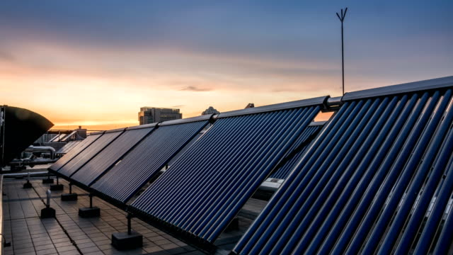 Solar pannels in city, timelapse sunset video