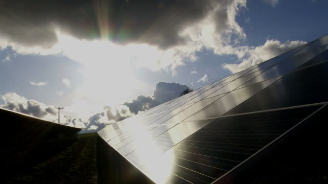 T/L Solar Park Against Dramatic Sky Dolly Shot video