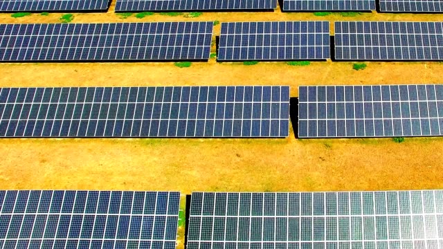 Solar power plant in agricultural landscape. Camera flight over a solar power plant in agricultural landscape. Industrial background on renewable resources theme. Industry of power and fuel generation in European Union. biofuel stock videos & royalty-free footage