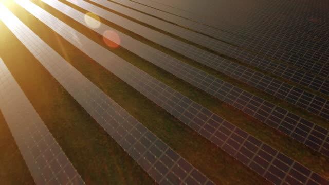 AERIAL Solar Power Station At Sunset Flyover Shot (4K/UHD)
