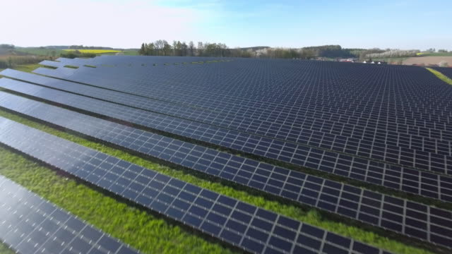 aerial solar power station flyover shot (4k/uhd) - solar panels stock videos & royalty-free footage