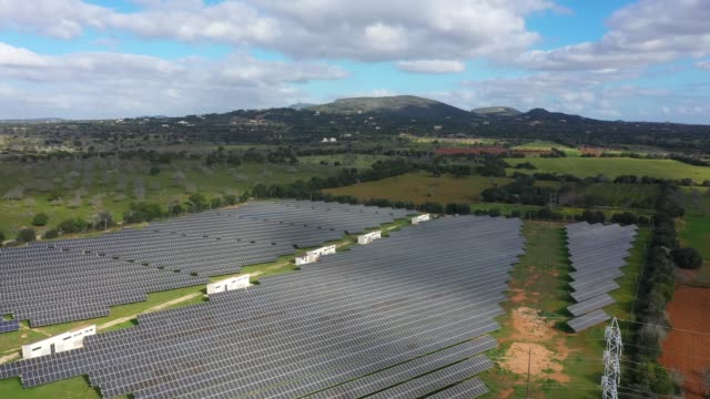 Solar station on a field Solar station on a field, view from drone cultivated land stock videos & royalty-free footage