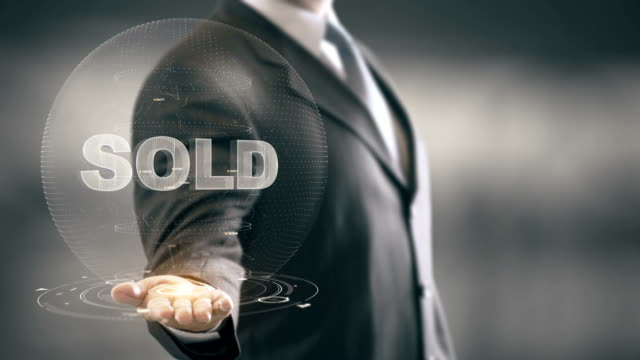 Sold Businessman Holding in Hand New technologies video