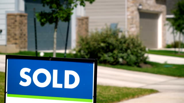 Sold sign in front of Suburban Home