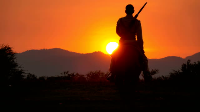 4K Soldier And Cowboy Riding Horses Walking Into The Sunset