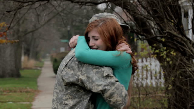 soldier coming home and hugging his wife - military lifestyle stock videos & royalty-free footage