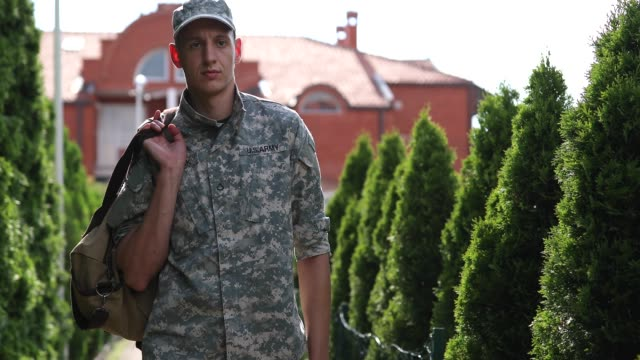 Soldier Coming Home With Amputee Leg Handsome Young Amputee Soldier Coming Home From Serving Military camouflage clothing stock videos & royalty-free footage