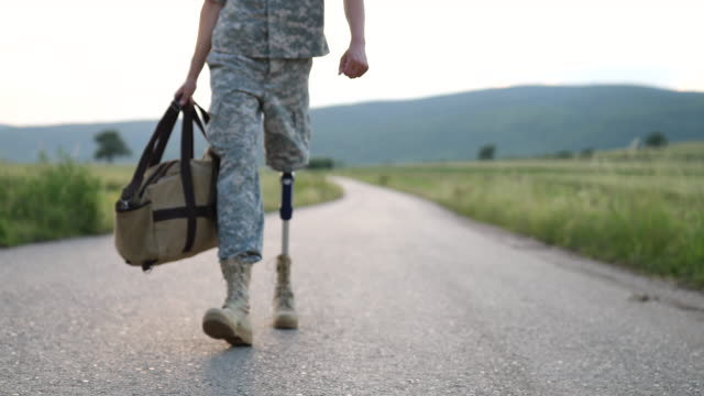 Soldier Coming Home With Amputee Leg Handsome Young Amputee Soldier Coming Home  From Serving Military prosthetic equipment stock videos & royalty-free footage