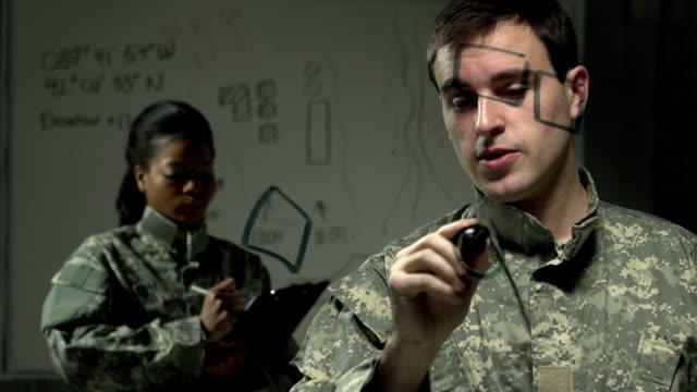 vídeos y material grabado en eventos de stock de soldier dibujo plan de acción sobre transparente, tabla de planchar - air force