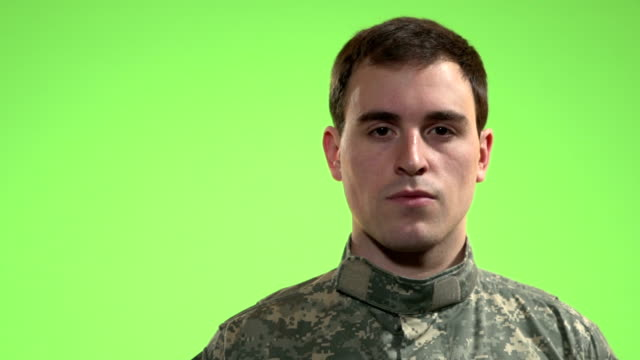 Soldier in front of green screen. video