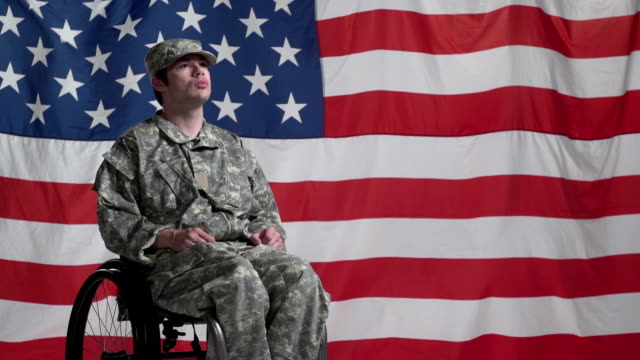 Soldier in wheelchair front of US flag video