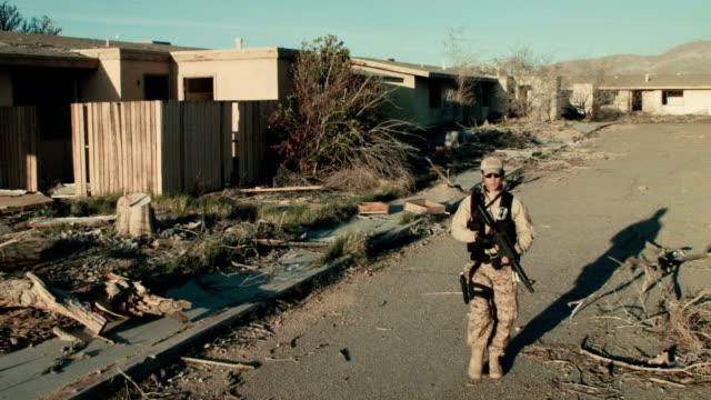 Soldier Patrolling Neigborhood (Multiple Jib shots) video