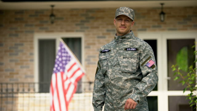 USA soldier showing keys from house, mortgage help from veterans organization USA soldier showing keys from house, mortgage help from veterans organization car rental stock videos & royalty-free footage