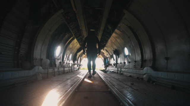 soldier walking through an abandoned military plane - military lifestyle stock videos & royalty-free footage