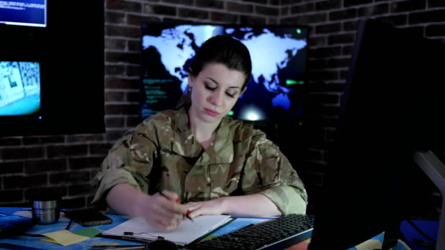 soldier woman portrait with computer, IT war, cyber safety video