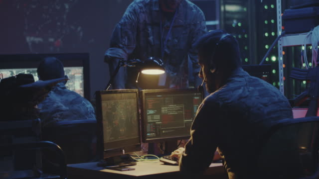 Soldier working on a computer video