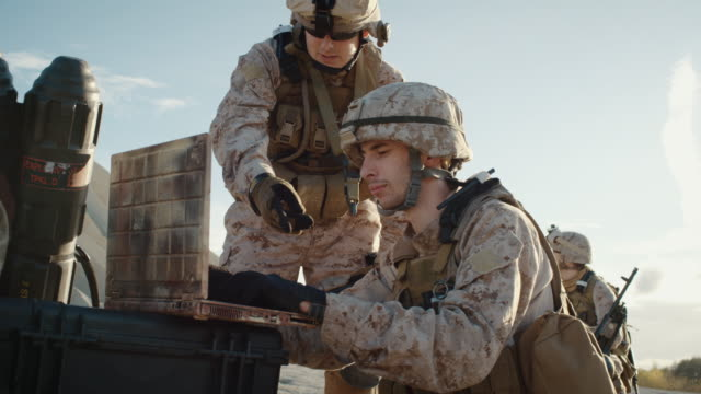 Soldiers are Using Laptop Computer for Surveillance During Military Operation in the Desert. video