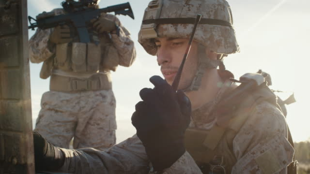 Soldiers are Using Radio For Communication During Military Operation in the Desert video