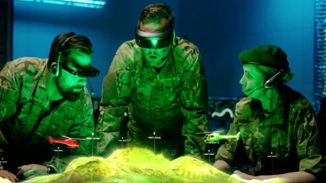 Soldiers discussing holographic landscape display video
