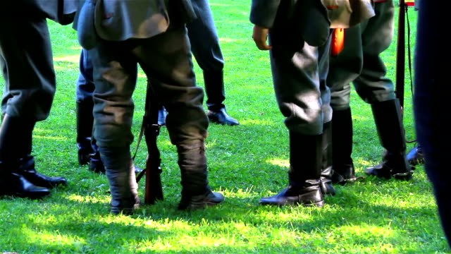 Soldiers feet with military uniform on field video