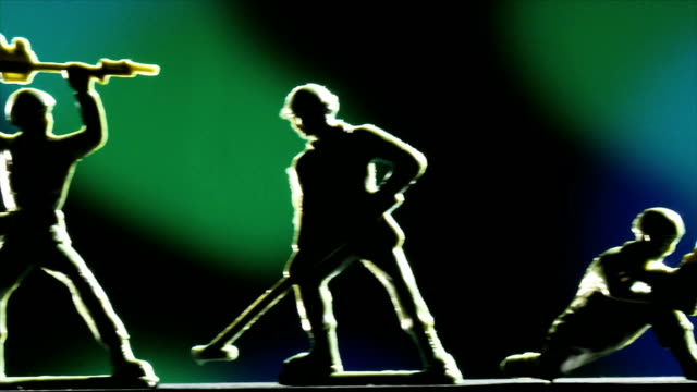Soldiers silhoutte on blue and green background video