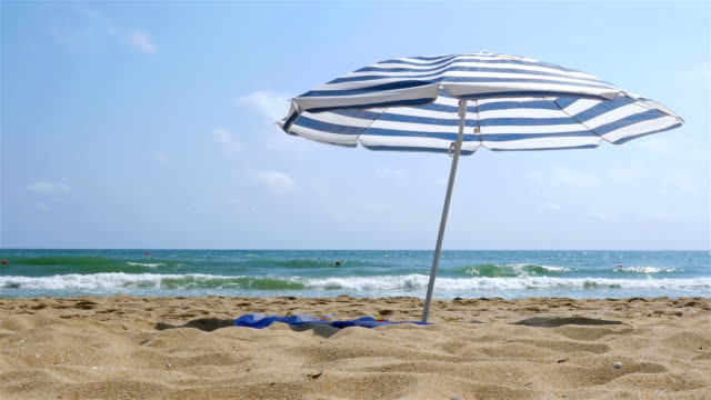 Solitary parasol on the sea beach video