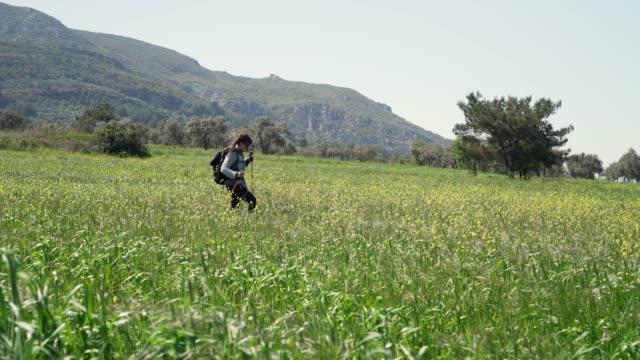 Solo female hiker in meadow