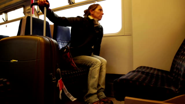 Solo Woman Traveler on Train with Luggage video
