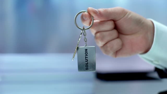 solution word on keychain hand showing to camera, accepting opportunity, startup - key ring stock videos & royalty-free footage