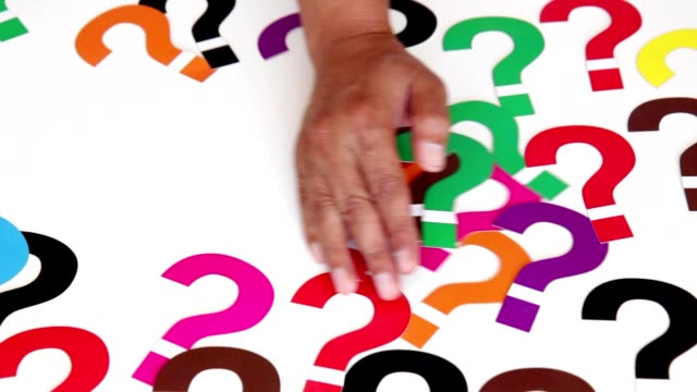 Solving Problem A hand sweeps the question marks. faq stock videos & royalty-free footage
