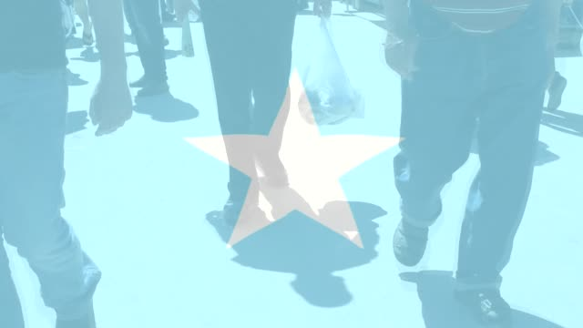 Somalia Flag and people walking as a background World Flag and people walking as a background horn of africa stock videos & royalty-free footage