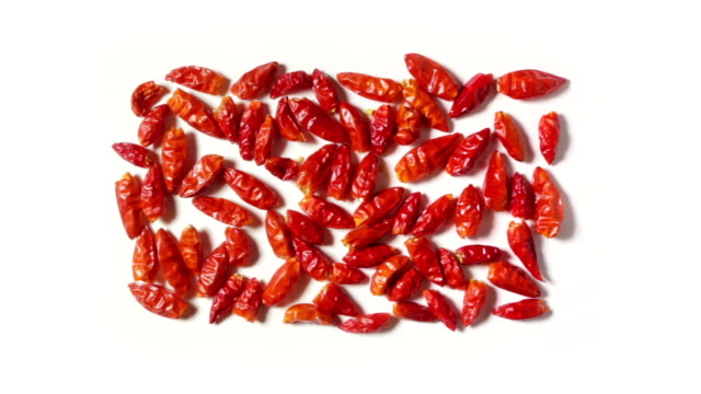 Some spicy red peppers, grouped in rectangular shape on a white plane, in zoom-in. Some spicy red peppers, grouped in rectangular shape on a white plane, in zoom-in. paprika stock videos & royalty-free footage