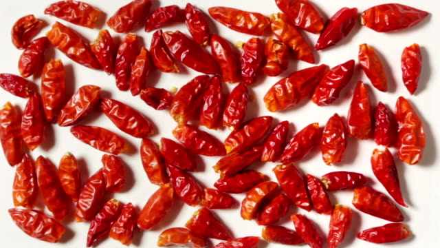 Some spicy red peppers, grouped in rectangular shape on a white plane, in zoom-out. Some spicy red peppers, grouped in rectangular shape on a white plane, in zoom-out. paprika stock videos & royalty-free footage
