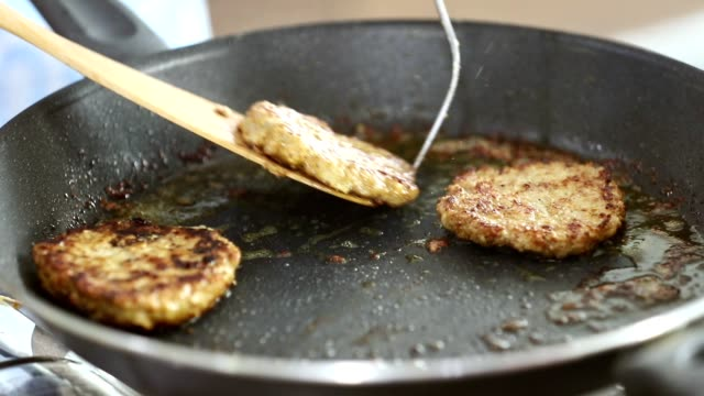 Someone grilled meat on pan for cooking good meal.