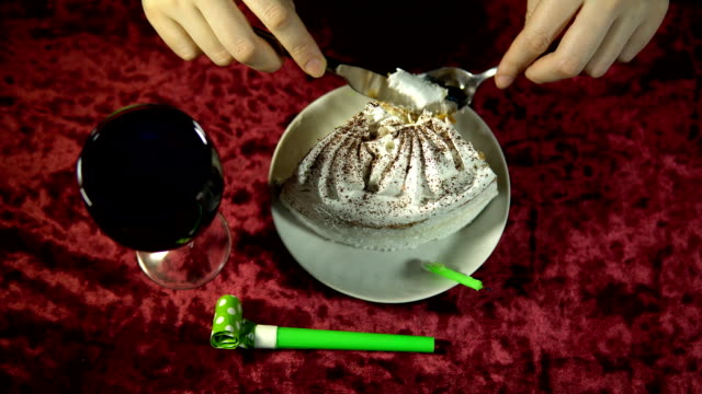 Someone is eating a holiday cake, top view of a festive background. video