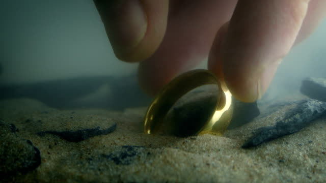 Someone Picks Up Gold Ring Underwater Closeup shot of a gold ring being picked up off the bed of lake or river knight person stock videos & royalty-free footage