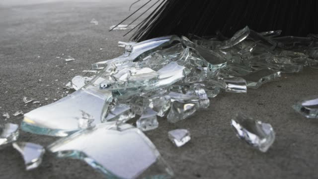 Someone Sweeps Broken Glass into a Pile with a Broom video