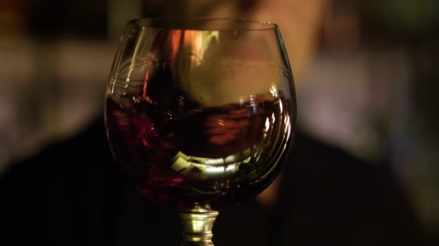 sommelier in winery pouring italian red wine in glass in slow motion sommelier in winery pouring italian red wine in glass in slow motion red wine stock videos & royalty-free footage