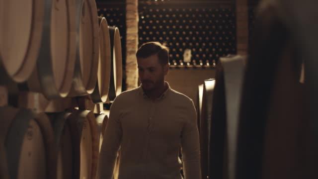 Sommelier walking through wine cellar