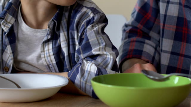 Son and single father having poor breakfast together, malnutrition, close up Son and single father having poor breakfast together, malnutrition, close up hungry child stock videos & royalty-free footage