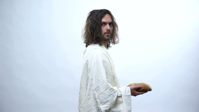 son of god holding bread, sacramental eucharist in catholic church, communion - communion stock videos and b-roll footage
