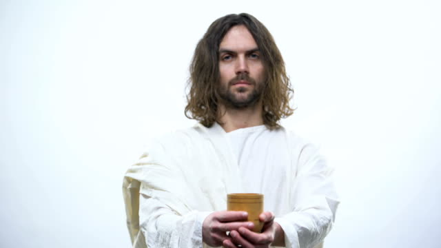 son of god holding wine, sacramental eucharist in catholic church, communion - communion stock videos and b-roll footage