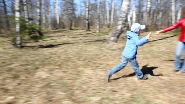 Son runs to mother in spring forest video