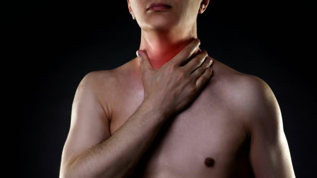 Sore throat, men with pain in neck, black background video