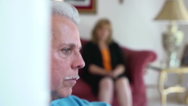 Sorrowful Latin Man with Woman in Background video